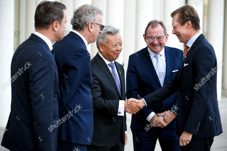 (L-R) Luxembourg's Prime Minister Xavier Bettel, Luxembourg's Finance Minister Pierre Gramegna and AIIB President Jin Liqun welcome the Grand Duke Henri of Luxembourg (R) prior to the 4th annual meeting of the Asian Infrastructure Investment Bank (AIIB) at the European Convention Centre in Luxembourg, 12 July 2019. The theme of the 2019 annual meeting is cooperation and connectivity in recognition of the economic and social benefits to be realized through better connectivity within and between countries and regions, including Europe and Asia. The dialogue will focus on how cooperation and strategic investments in sustainable infrastructure can contribute to deeper integration and stronger economic growth via enhanced and strengthened connectivity.