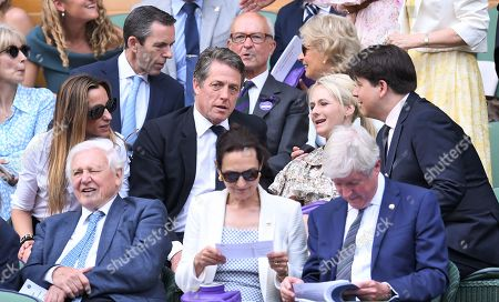 Stock Photo of Hugh Grant and Anna Elisabet Eberstein, Michael McIntyre and Kitty McIntyre in the Royal Box on Centre Court