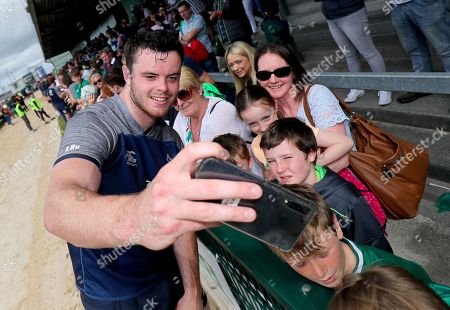 James Ryan takes a selfie with fans after training