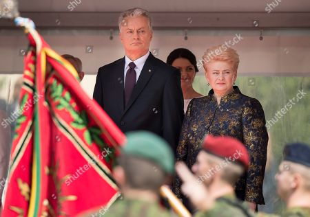 Stock Picture of Gitanas Nauseda, Dalia Grybauskaite. Lithuanian new President Gitanas Nauseda and Lithunania's former President Dalia Grybauskaite, right, review the military after Nauseda's inauguration ceremony at the Lithuanian parliament in Vilnius, Lithuania