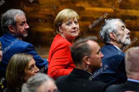 (L-R) The President of the Prussian Cultural Heritage Foundation Hermann Parzinger, German Chancellor Angela Merkel and Timothy M. Simon attend the official opening of the 'James-Simon-Galerie' building at the Museum Island in Berlin, Germany, 12 July 2019. The building is the new central entrance for the Berlin historic Museums Island and was designed by British architect David Chipperfield.