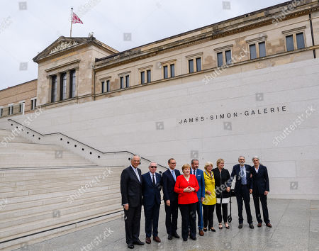 (L-R) The Director General of the National Museums in Berlin Michael Eissenhauer, British architect David Chipperfield, Berlin Governing Mayor Michael Mueller, German Chancellor Angela Merkel, President of the Prussian Cultural Heritage Foundation Hermann Parzinger, German State Culture Minister Monika Gruetters, Ann Simon, Timothy M. Simon and architect Alexander Schwarz pose for a group photo during the officially opening of the 'James-Simon-Galerie' building at the Museum Island in Berlin, Germany, 12 July 2019. The building is the new central entrance for the Berlin historic Museums Island and was designed by British architect David Chipperfield.