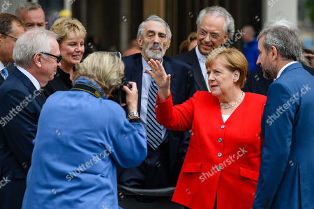 (L-R) British architect David Chipperfield, Ann Simon, Timothy M. Simon, Director general of the National Museums in Berlin Michael Eissenhauer, German Chancellor Angela Merkel and the President of the Prussian Cultural Heritage Foundation Hermann Parzinger attend the official opening of the 'James-Simon-Galerie' building at the Museum Island in Berlin, Germany, 12 July 2019. The building is the new central entrance for the Berlin historic Museums Island and was designed by British architect David Chipperfield.