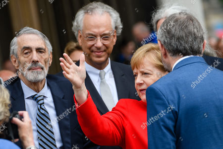 (L-R) Timothy M. Simon, the Director General of the National Museums in Berlin Michael Eissenhauer, German Chancellor Angela Merkel and the President of the Prussian Cultural Heritage Foundation Hermann Parzinger attend the official opening of the 'James-Simon-Galerie' building at the Museum Island in Berlin, Germany, 12 July 2019. The building is the new central entrance for the Berlin historic Museums Island and was designed by British architect David Chipperfield.