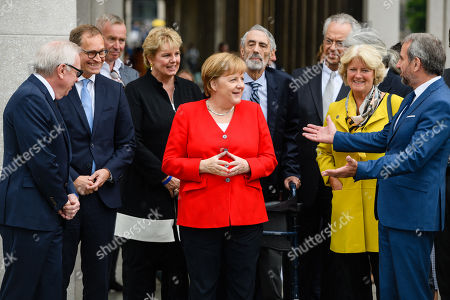(L-R) British architect David Chipperfield, Berlin Governing Mayor Michael Mueller, Ann Simon, German Chancellor Angela Merkel, Timothy M. Simon, Director general of the National Museums in Berlin Michael Eissenhauer, German State Culture Minister Monika Gruetters and the President of the Prussian Cultural Heritage Foundation Hermann Parzinger attend the official opening of the 'James-Simon-Galerie' building at the Museum Island in Berlin, Germany, 12 July 2019. The building is the new central entrance for the Berlin historic Museums Island and was designed by British architect David Chipperfield.