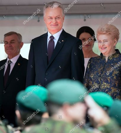 Stock Image of Lithuanian new President Gitanas Nauseda and Lithunania's former President Dalia Grybauskaite, right, review the military after Nauseda's inauguration ceremony at the Lithuanian parliament in Vilnius, Lithuania