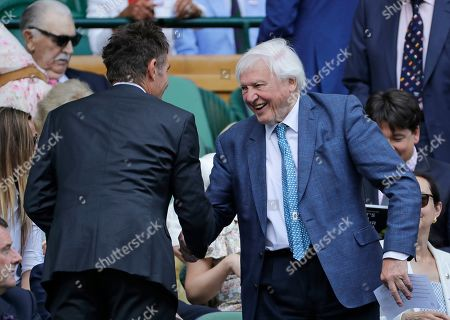 Former Wimbledon tennis champion Pat Cash shakes hands withSir Sir David Attenborough in the Royal Box on Centre Court to watch a Men's singles semifinal match on day eleven of the Wimbledon Tennis Championships in London