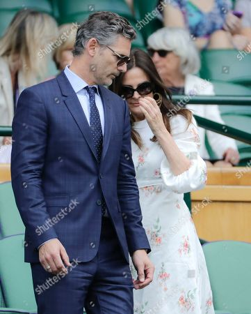 Actor Eric Bana takes his seat in the Royal Box on Centre Courtduring a men's singles semifinal match on day eleven of the Wimbledon Tennis Championships in London