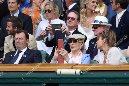 Princess Michael of Kent captures an image of Centre Court from the Royal Box on day eleven of the Championships