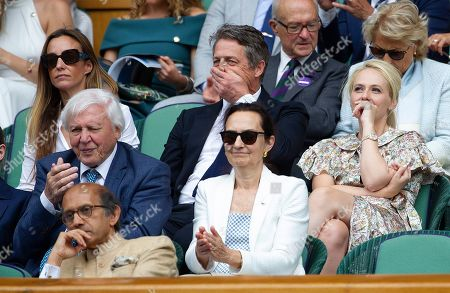 Hugh Grant, wife Anna and Kitty McIntyre  in the Royal Box at Wimbledon on day eleven of the Championships