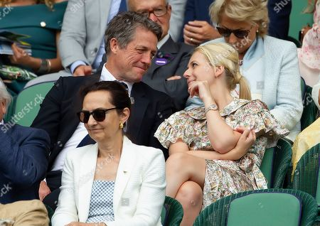 Hugh Grant and Kitty McIntyre  in the Royal Box at Wimbledon on day eleven of the Championships