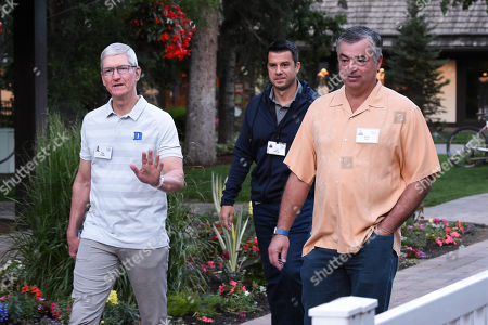 Tim Cook, CEO of Apple, Jim Neidig and Eddy Cue, Senior VP of Internet Software and Services at Apple