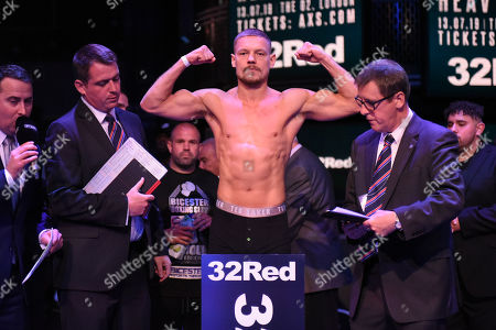 Scott James on the scales during a Weigh In at the BT Studios, Queen Elizabeth Olympic Park on 12th July 2019