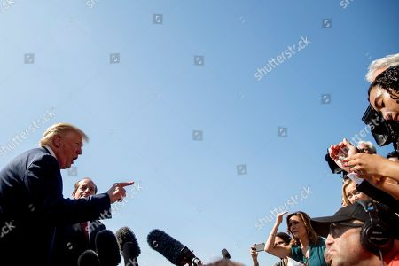 Donald Trump, Alex Acosta. President Donald Trump, accompanied by Labor Secretary Alex Acosta, second from left, speaks to members of the media on the South Lawn of the White House in Washington, before Trump boards Marine One for a short trip to Andrews Air Force Base, Md. and then on to Wisconsin. Trump says Labor Secretary Alex Acosta to step down, move comes in wake of handling of Jeffrey Epstein case