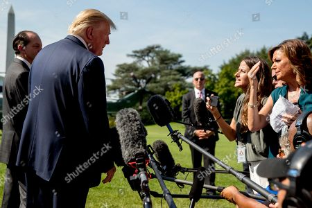 Donald Trump, Alex Acosta. President Donald Trump, accompanied by Labor Secretary Alex Acosta, left, speaks to members of the media on the South Lawn of the White House in Washington, before Trump boards Marine One for a short trip to Andrews Air Force Base, Md. and then on to Wisconsin. Trump says Labor Secretary Alex Acosta to step down, move comes in wake of handling of Jeffrey Epstein case