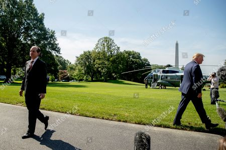 Donald Trump, Alex Acosta. Labor Secretary Alex Acosta, left, walks back into the White House as President Donald Trump, right, speaks to members of the media on the South Lawn in Washington, before Trump boards Marine One for a short trip to Andrews Air Force Base, Md. and then on to Wisconsin. Trump says Labor Secretary Alex Acosta to step down, move comes in wake of handling of Jeffrey Epstein case