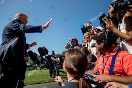 President Donald Trump speaks to members of the media on the South Lawn of the White House in Washington, before boarding Marine One for a short trip to Andrews Air Force Base, Md. and then on to Wisconsin. Trump says Labor Secretary Alex Acosta to step down, move comes in wake of handling of Jeffrey Epstein case
