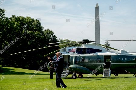 President Donald Trump points to guests on the South Lawn of the White House in Washington, before boarding Marine One for a short trip to Andrews Air Force Base, Md. and then on to Wisconsin. Trump says Labor Secretary Alex Acosta to step down, move comes in wake of handling of Jeffrey Epstein case