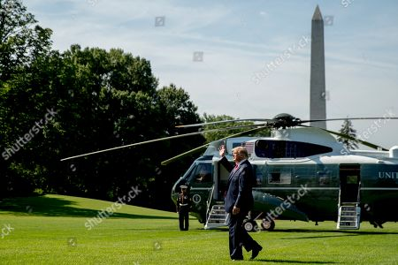 President Donald Trump waves to guests on the South Lawn of the White House in Washington, before boarding Marine One for a short trip to Andrews Air Force Base, Md. and then on to Wisconsin. Trump says Labor Secretary Alex Acosta to step down, move comes in wake of handling of Jeffrey Epstein case