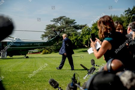 President Donald Trump walks across the South Lawn of the White House in Washington, before boarding Marine One for a short trip to Andrews Air Force Base, Md. and then on to Wisconsin. Trump says Labor Secretary Alex Acosta to step down, move comes in wake of handling of Jeffrey Epstein case