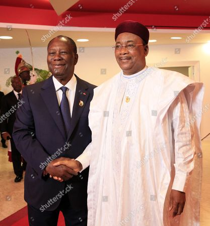Ivorian President Alassane Ouattara (L) greets President of Niger Mahamadou Issoufou (R) at the 21st Summit of Heads of State of the West African Monetary Union (UEMOA) in Abidjan, Ivory Coast, 12 July 2019. The eight-state organization was established in 1994 to promote economic integration among countries that use the West African CFA franc as their currency.