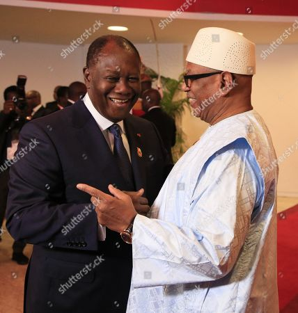 Ivorian President Alassane Ouattara (L) greets Mali President Ibrahim Boubacar Keita (R) at the 21st Summit of Heads of State of the West African Monetary Union (UEMOA) in Abidjan, Ivory Coast, 12 July 2019. The eight-state organization was established in 1994 to promote economic integration among countries that use the West African CFA franc as their currency.