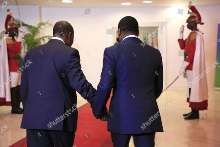 Ivorian President Alassane Ouattara (L) greets President of Togo Faure Gnassingb (R) at the 21st Summit of Heads of State of the West African Monetary Union (UEMOA) in Abidjan, Ivory Coast, 12 July 2019. The eight-state organization was established in 1994 to promote economic integration among countries that use the West African CFA franc as their currency.