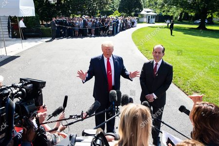 US President Donald J. Trump (L) delivers remarks to members of the news media beside US Labor Secretary Alex Acosta (R), before departing the South Lawn of the White House in Washington, DC, USA, 12 July 2019. Before leaving for a day trip to Wisconsin and Ohio, President Trump announced that US Labor Secretary Alex Acosta will resign following criticism of the way Acosta handled a sex crimes case against Jeffrey Epstein when he was US attorney for southern Florida.