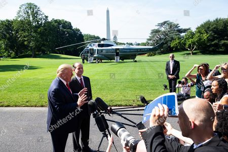 US President Donald J. Trump (L) delivers remarks to members of the news media beside US Labor Secretary Alex Acosta (2-L), before departing the South Lawn of the White House in Washington, DC, USA, 12 July 2019. Before leaving for a day trip to Wisconsin and Ohio, President Trump announced that US Labor Secretary Alex Acosta will resign following criticism of the way Acosta handled a sex crimes case against Jeffrey Epstein when he was US attorney for southern Florida.