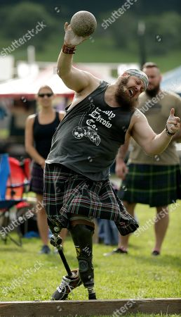 Stock Photo of Matthew Hall, of Roanoke, Va., competes in the weight toss event during the 64th Annual Grandfather Mountain Highland Games at MacRae Meadows in Linville, N.C., . The games celebrate the history and culture of Scottish people