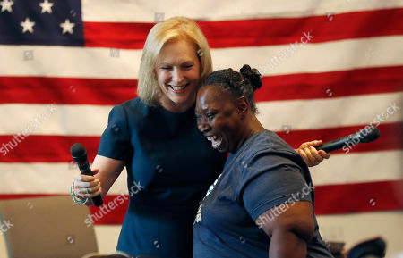 Democratic presidential candidate Sen. Kirsten Gillibrand, D-N.Y., is hugged by Veronica Taylor at a town hall meeting during a campaign stop in Bloomfield Hills, Mich