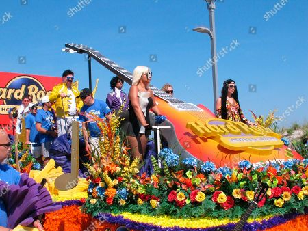 Stock Photo of This photo shows employees of the Hard Rock casino in Atlantic City N.J. portraying musical artists including Lady Gaga, Cher, Freddie Mercury and Prince during a parade on the casino's first anniversary. Extra money from sports betting helped New Jersey's casinos and racetracks win nearly $284 million in June, up 21.5 percent from a year ago