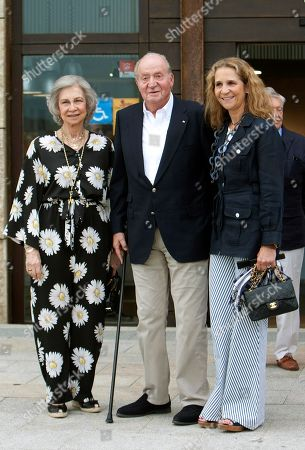 Spain's Emeritus King Juan Carlos I (C) and Queen Sofia (L) and their daughter Princess Elena (R) pose for the photographers upon their arrival in Royal Yacht Club in Sanxenxo, northwestern Spain, 12 July 2019. Spain's Emeritus royal couple attended a dinner to pay tribute to the Spanish Navy.