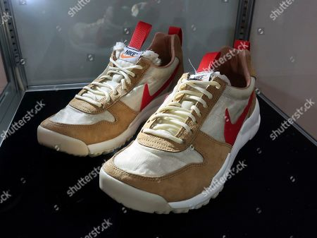 "A pair of 2012 ""Tom Sachs X Nikecraft Mars Yard"" shoes are on display at Sotheby's auction house in New York on . Sotheby's expects two pairs of the shoes to auction online for $9,000 to $12,000"
