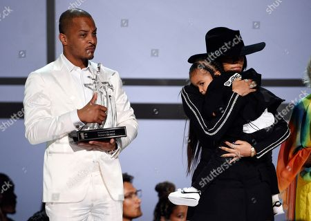 T.I., Lauren London, Kross Asghedom. Lauren London, far right, widow of the late rapper Nipsey Hussle, holds their son Kross onstage as presenter T.I. holds a Humanitarian Award for Hussle during the 2019 BET Awards at Microsoft Theatre, in Los Angeles