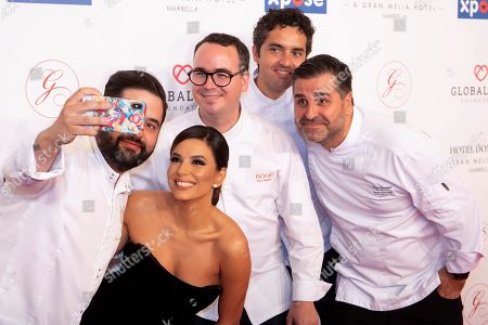 Chefs Juan Luis Fernandez (L), Paco Morales (3L), Juan Jose Carmona (2R), Víctor Carracedo (R), and US actress Eva Longoria (2-L) pose upon their arrival to the VIII Global Gift gala in Marbella, Spain, 12 July 2019.  The event is part of the Philanthropic Weekend activities organized by the Global Gift Foundation.