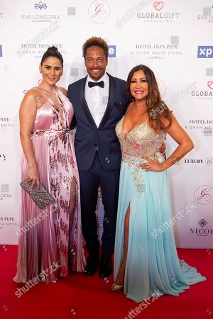 (L-R) Singer Rosa Lopez, US actor Gary Dourdan and actress Maria Bravo pose upon their arrival to the VIII Global Gift gala in Marbella, Spain, 12 July 2019. The event is part of the Philanthropic Weekend activities organized by the Global Gift Foundation.