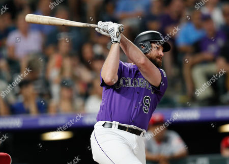 Daniel murphy, r m. Colorado Rockies' Daniel Murphy watches his solo home run off Cincinnati Reds relief pitcher David Hernandez during the eighth inning of a baseball game, in Denver