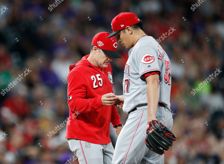Stock Photo of David bell. Cincinnati Reds manager David Bell, left, takes the ball from relief pitcher David Hernandez, who had given up a double to Colorado Rockies' Ian Desmond during the eighth inning of a baseball game, in Denver