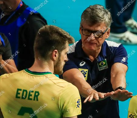 Brazil head coach Renan Dal Zotto (R) talks to Brazil's Eder Carbonera (L) during the FIVB Volleyball Men's Nations League match between Brazil and Iran at Credit Union 1 Arena in Chicago, Illinois, USA, 12 July 2019.