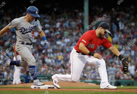 Austin Barnes, Michael Chavis. Los Angeles Dodgers' Austin Barnes is out at first on a ground ball as Boston Red Sox first baseman Michael Chavis catches the throw from third during the second inning of a baseball game at Fenway Park, in Boston