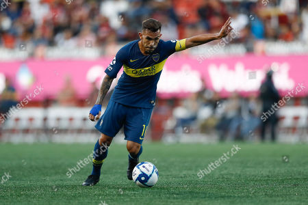 Boca Juniors's Carlos Tevez during the first half of a friendly soccer match against Tijuana, in Tijuana, Mexico
