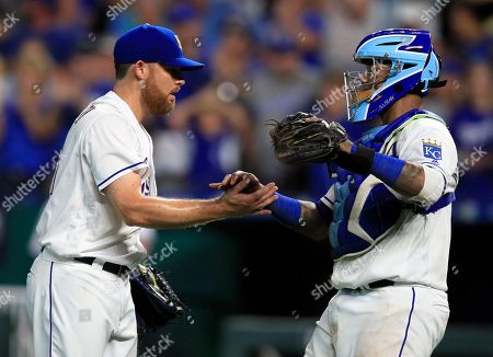 Ian Kennedy, Martin Maldonado. Kansas City Royals relief pitcher Ian Kennedy, left, shakes hands with catcher Martin Maldonado following the Royals' 8-5 win over the Detroit Tigers in a baseball game at Kauffman Stadium in Kansas City, Mo