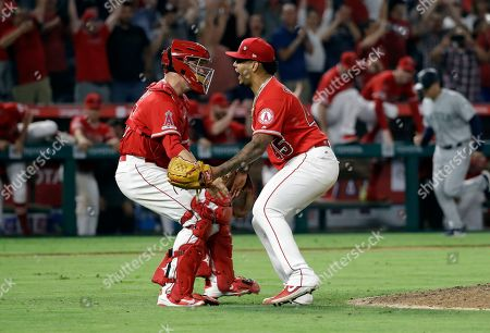 Felix Pena, Dustin Garneau. Los Angeles Angels relief pitcher Felix Pena, right, celebrates with catcher Dustin Garneau after the Angels threw a combined no-hitter against the Seattle Mariners during a baseball game, in Anaheim, Calif. Taylor Cole pitched the first two innings