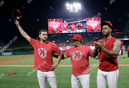 Taylor Cole, Felix Pena. Los Angeles Angels starting pitcher Taylor Cole, left, and relief pitcher Felix Pena, right, alongside Pena's interpreter, middle, acknowledge the crowd's applause after a combined no-hitter against the Seattle Mariners during a baseball game, in Anaheim, Calif. The Angels won 13-0