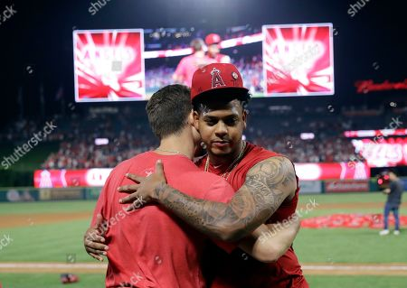 Felix Pena, Taylor Cole. Los Angeles Angels relief pitcher Felix Pena, right, hugs starter Taylor Cole after they threw a combined-no hitter against the Seattle Mariners during a baseball game, in Anaheim, Calif. The Angels won 13-0