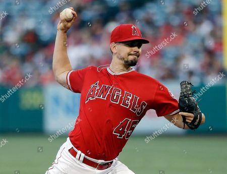 Los Angeles Angels starting pitcher Taylor Cole throws to a Seattle Mariners batter during the first inning of a baseball game, in Anaheim, Calif
