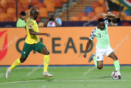 Ahmed Musa of Nigeria challenged by Thamsanqa Mkhize of South Africa