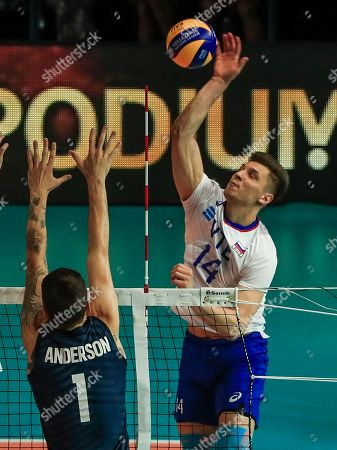 Russia's Yaroslav Podlesnykh (R) in action against USA's Matthew Anderson (L) during the FIVB Volleyball Men's Nations League match between Russia and the USA at Credit Union 1 Arena in Chicago, Illinois, USA, 12 July 2019.