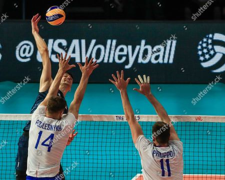 USA's Matthew Anderson (L, back) in action against Russia's Yaroslav Podlesnykh (L, front) and Russia's Igor Philippov (R) during the FIVB Volleyball Men's Nations League match between Russia and the USA at Credit Union 1 Arena in Chicago, Illinois, USA, 12 July 2019.
